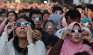 The future's bright ... people observe the solar eclipse in Jakarta in March 2016.