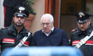 Settimo Mineo is escorted by Italian police officers after his arrest in Palermo