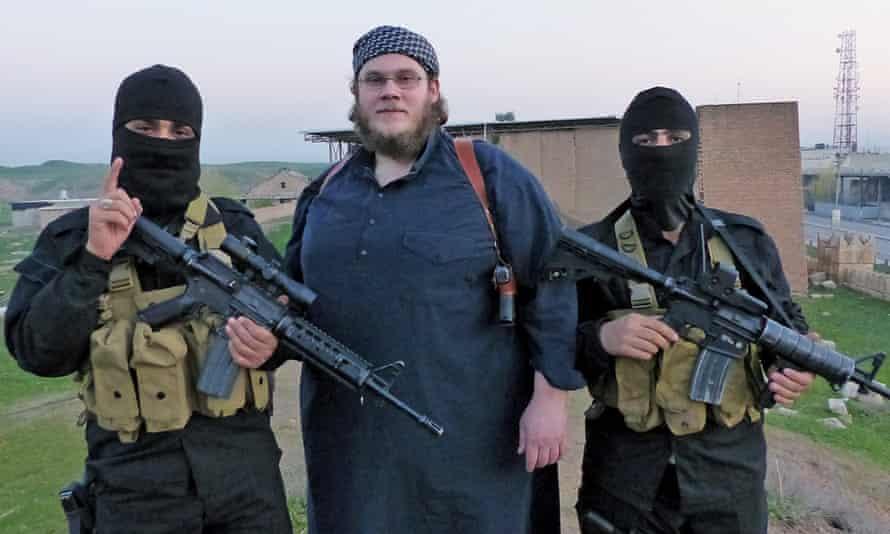 Journalist Jürgen Todenhöfer was guided through Isis by Muslim convert Abu Qatadah (pictured centre) and bodyguards.