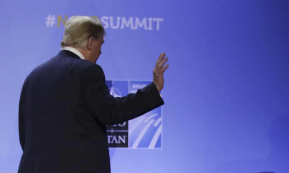 Donald Trump leaves Nato press conference
