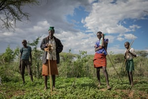 Pokot herders stand in a community pasture reserved for the dry season nearby the town of Loruk