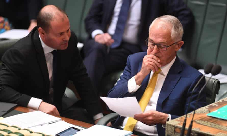 Malcolm Turnbull (right) speaks to minister for energy and the environment Josh Frydenberg on Monday