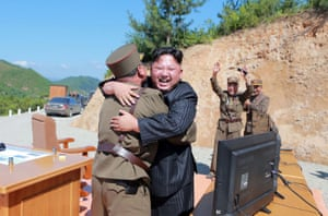 The North Korean leader, Kim Jong-un, celebrates the successful test-fire of an intercontinental ballistic missile on 4 July