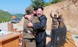 Kim Jong-Un celebrating the successful test-fire of the intercontinental ballistic missile in July.
