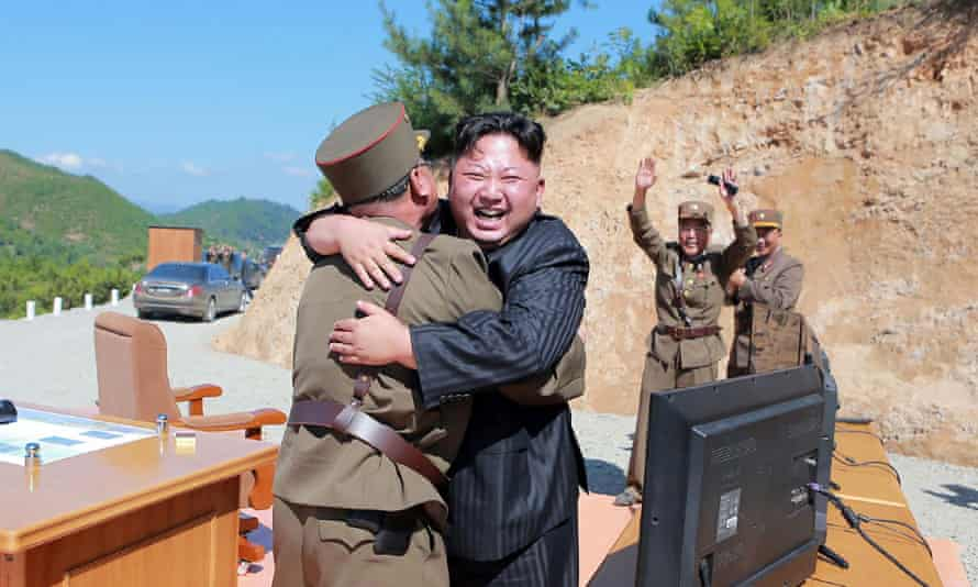 This picture taken on July 4, 2017 and released by North Korea's official Korean Central News Agency (KCNA) on July 5 shows North Korean leader Kim Jong-Un (C) celebrating the successful test-fire of the intercontinental ballistic missile Hwasong-14 at an undisclosed location