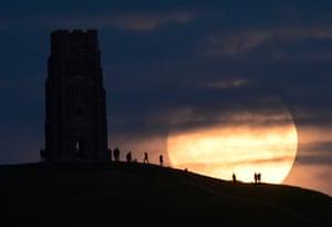 The moon rises near Glastonbury