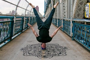 Instagram user @jmicks shows off his headstand ability on New York's Brooklyn Bridge