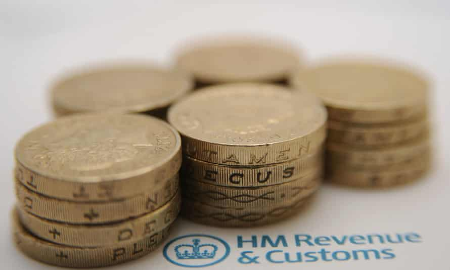 Piles of £1 coins next to HMRC logo