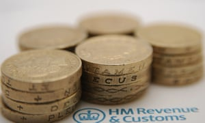 pounds coins and an HMRC tax form