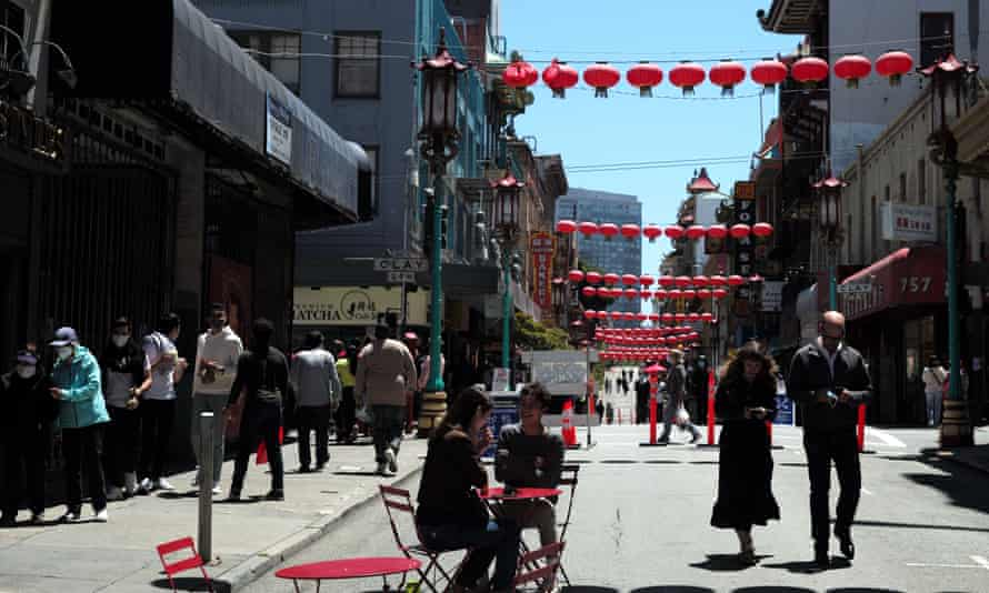 People stroll in Chinatown in San Francisco, California, on 22 May 2021. California plans to fully reopen its economy on 15 June.