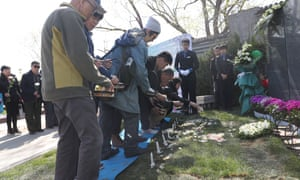 Seven families lay the remains of their loved ones to rest in the Tianshou cemetery on the outskirts of Beijing.