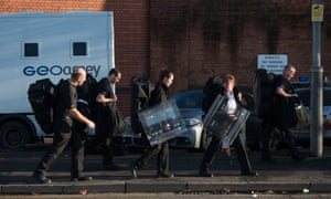 Prison staff carrying riot shields leaving HMP Birmingham in Winson Green, Birmingham, on Friday. In a Commons statement on the riot Liz Truss, the justice secretary, said the problems in prisons would not be solved quickly.