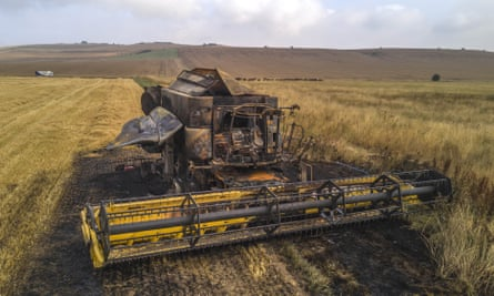 A burnt-out combine harvester in Wiltshire. Their blades can strike a stone and create a spark, which could be enough to start a fire in dry conditions.