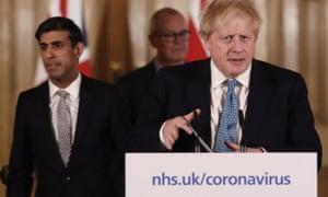 Britain's chancellor, Rishi Sunak, left, and the prime minister, Boris Johnson, at a coronavirus press briefing.
