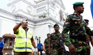 Security staff stand guard outside St Anthony's church in Colombo