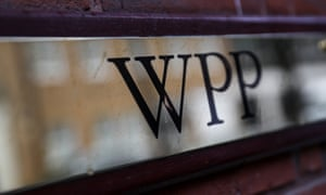 A logo hangs on the wall outside the WPP offices in London