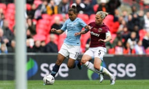 Gilly Flaherty (right) challenges Nikita Parris at Wembley.
