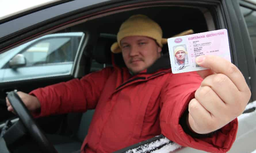 A man holding up Pastafarian licence