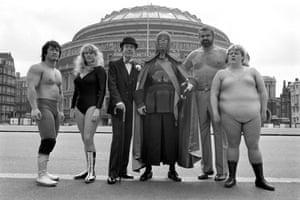 "Fuji Yamada (left), Mitzi Mueller, Gorgeous George, Kendo Nagasaki, ""Mighty"" John Quinn and Klondyke Kate (right)."
