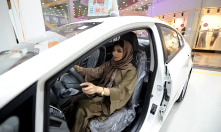 A Saudi woman tries out a car at a showroom in Jeddah