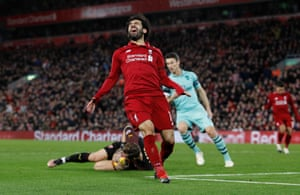 Mohamed Salah reacts after Arsenal's Bernd Leno takes the ball.