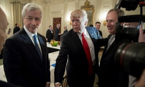 Donald Trump greets business leaders beside president and CEO of JP Morgan Jamie Dimon, at the White House in 2017.