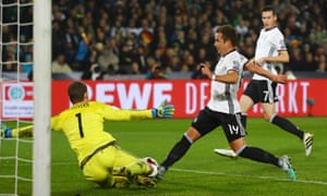 Northern Ireland's Michael McGovern saves from Germany's Mario Gotze.