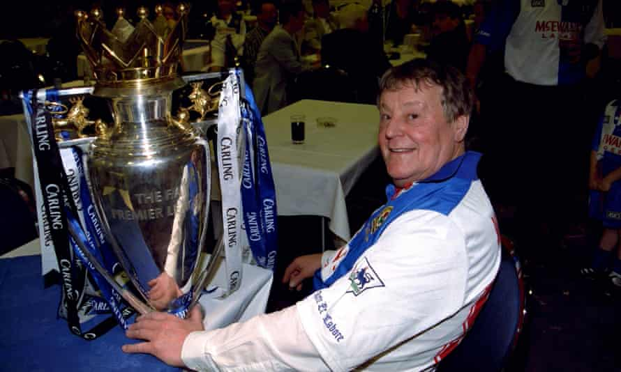 Jack Walker has a moment with the Premier League trophy after the presentation.