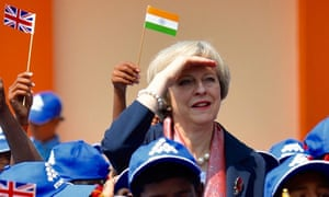 Theresa May with schoolchildren during her visit to Bangalore, India.
