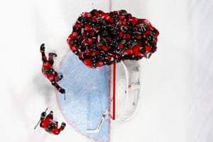 Canada's players celebrate winning the women's preliminary round ice hockey match against the US.