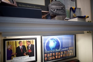 Another photo of George W Bush, an award from the Faith and Family Awards and a framed magazine page in which he is mentioned
