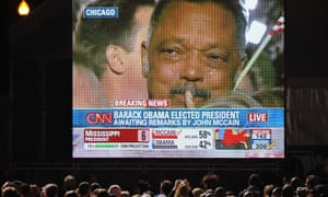 The image of a weeping Rev Jesse Jackson is projected on to a large screen as CNN announces the victory of Barack Obama on 4 November 2008.