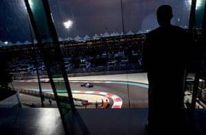 A fan watches the Abu Dhabi Formula One Grand Prix at the Yas Marina circuit