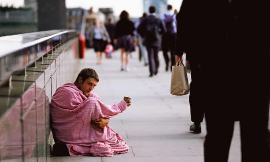 Young man begs from commuters on London Bridge in 2006