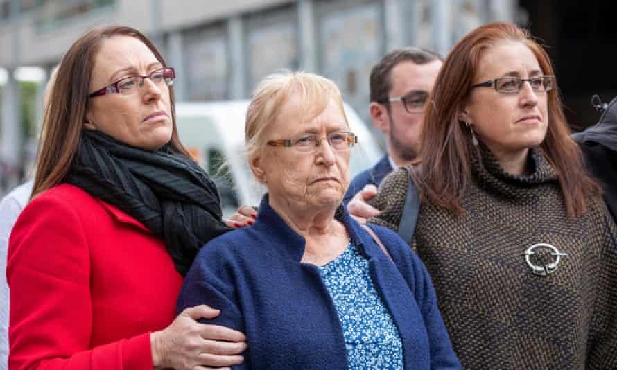 Joe McCann's widow, Anne, centre, leaves the court in Belfast