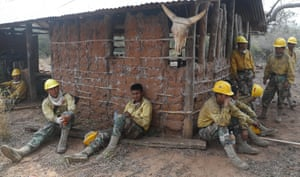 Soldiers take a break from fighting fires in the Chiquitano dry forest.