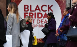 London, UK Shoppers walk past a store offering Black Friday sales in London. The UK is set to spend £2.5bn this weekend. Find all the best deals in one place