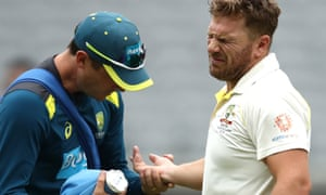 Aaron Finch receives treatment on injured finger