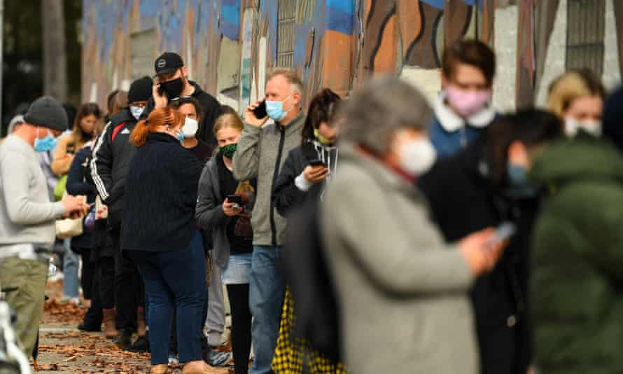 People wait in a line to receive Covid test at a walk-in testing facility in Melbourne on Wednesday.
