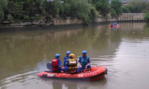 Rescuers search for victims after two dragon boats capsized in a river in southern China.