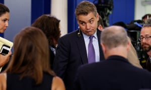 Acosta talks with fellow reporters after the daily press briefing at the White House in Washington Wednesday.