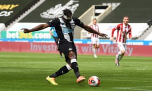 Newcastle United's Allan Saint-Maximin scores his side's first goal.