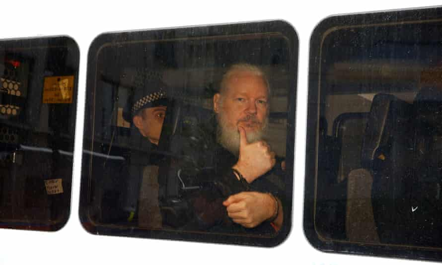 Assange in a police van after he was arrested by British police.