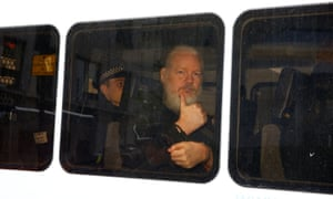 WikiLeaks founder Julian Assange in a police van after he was arrested by British police outside the Ecuadorian embassy in London.