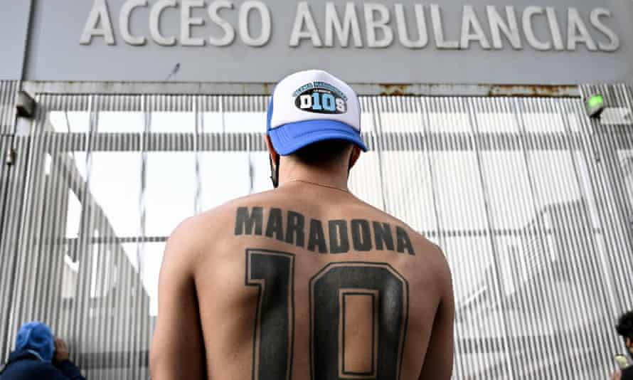 A Diego Maradona fan outside the hospital where the former Argentina interntional had surgery.