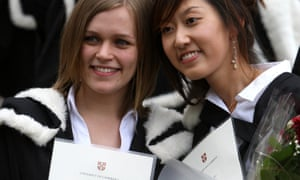New graduates of the University of Cambridge pose with their degree certificates in 2008.