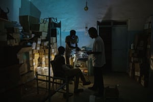 A surgeon checks a Tigrayan patient at a clinic near the Sudan-Ethiopia border.