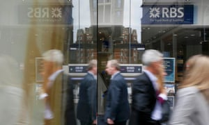 Pedestrians reflected in the glass as they pass an RBS branch in central London