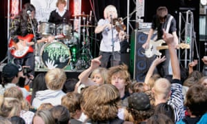 A crowd celebrates Youth Week watching a band