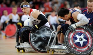Great Britain's wheelchair rugby team in action against the USA at the 2012 Olympics, with GB player Aaron Phipps chased by Chuck Aoki.